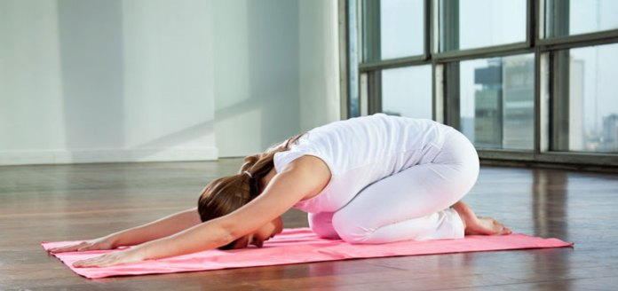 Make Mine a Forward Bend, With a Twist: 5 Reasons to Find Happy Hour on the Yoga Mat Tonight.