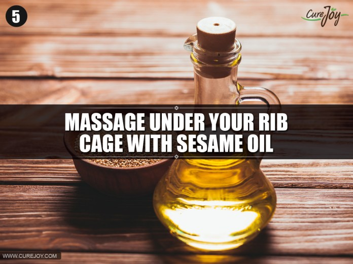 5-Massage-under-your-rib-cage-with-sesame-oil