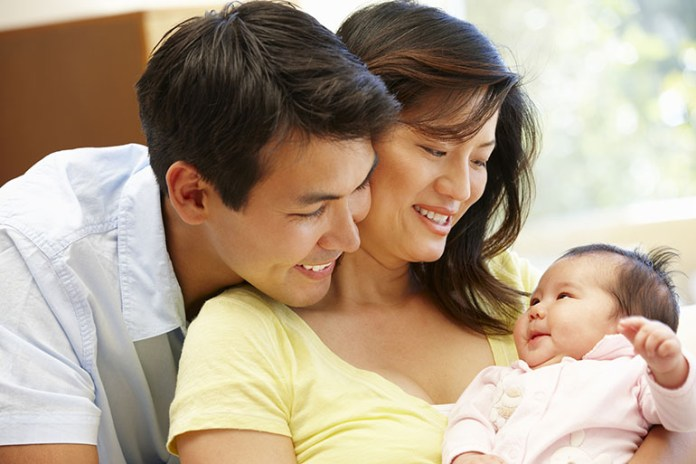 Cuddling newborn: 10 Little Things You Will Love About Your Newborn