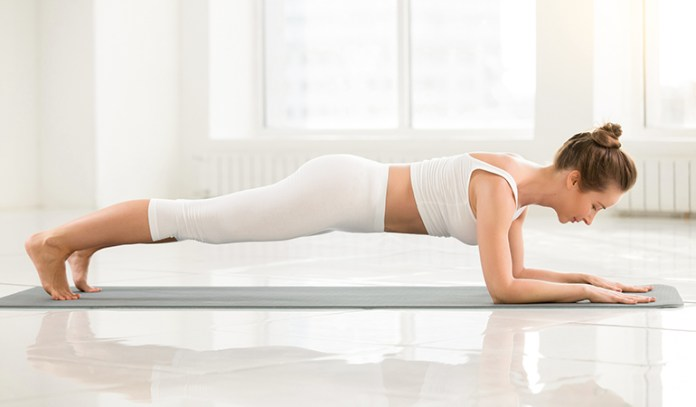 The Dolphin Plank (Makara Adho Mukha Svanasana)_Yoga Asanas For Upper, Middle, and Lower Back Pain Relief