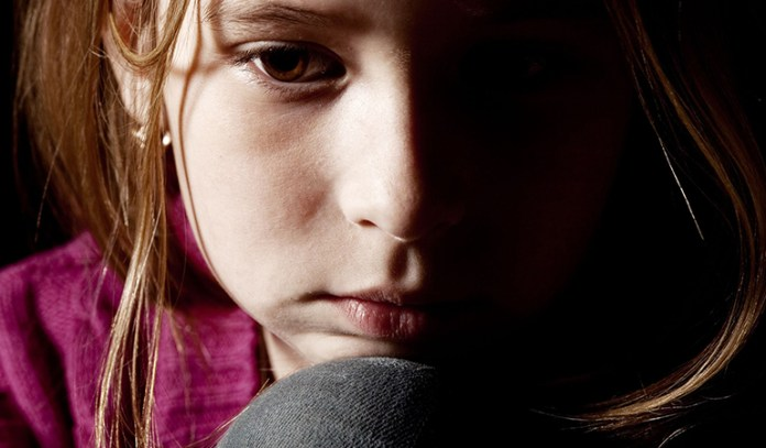 long term effects precocious puberty depression