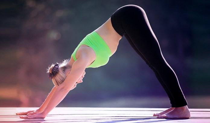 : A woman practicing downward-facing dog pose.