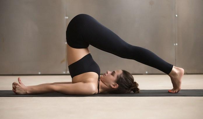 Halasana Yoga Pose Can Help People With Thyroid Problem