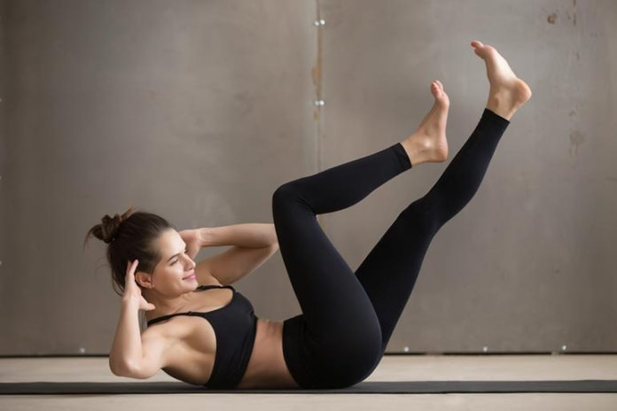 Bicycle crunches help work out your core muscles