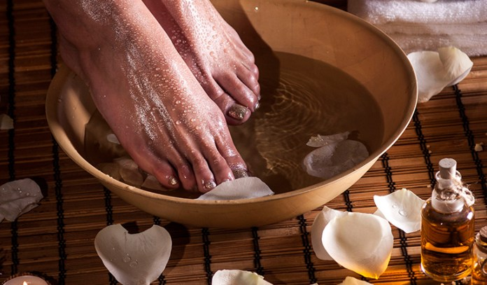 Soak the area that pains in water mixed with apple cider vinegar