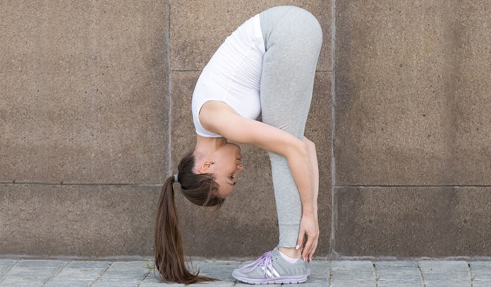 Straight legs in the standing forward bend can lead to back pain