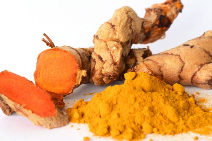 Toothpaste and turmeric to treat pimples