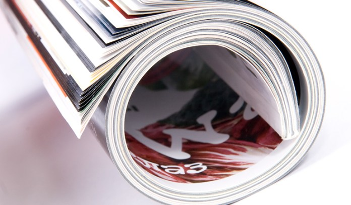 Keep Your High Boots In Shape With A Rolled Magazine