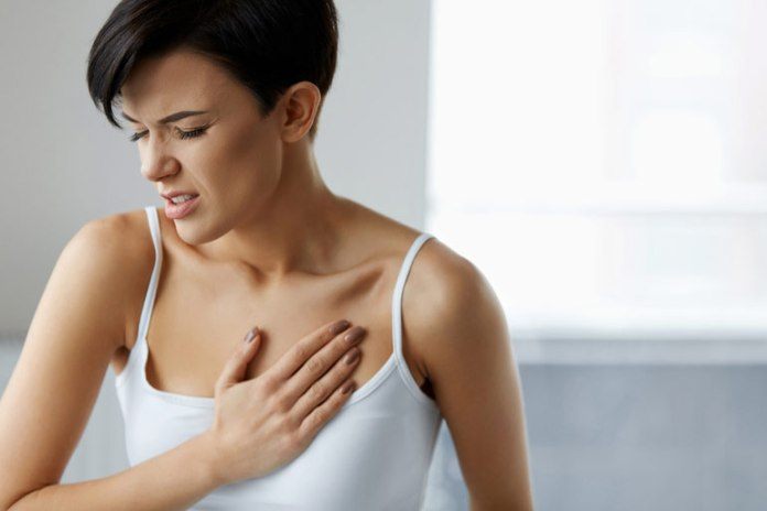 Heart attacks cause a constricting pain in the chest which is accompanied by sweating and dizziness.