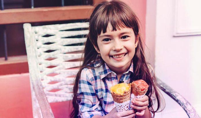Sugar provides food to bacteria that secrete acids that break down the teeth's enamel
