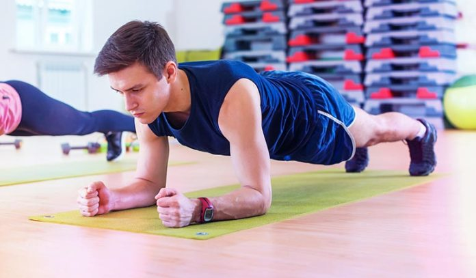 Start in a pushup position