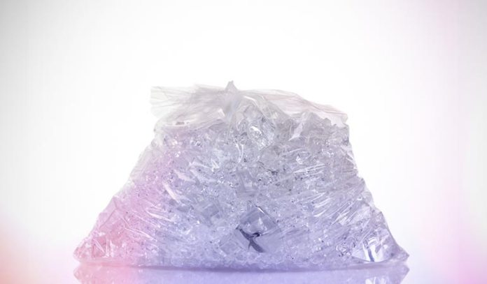 (Ice therapy is done by using crushed ice in a plastic bag to relieve foot pain.)