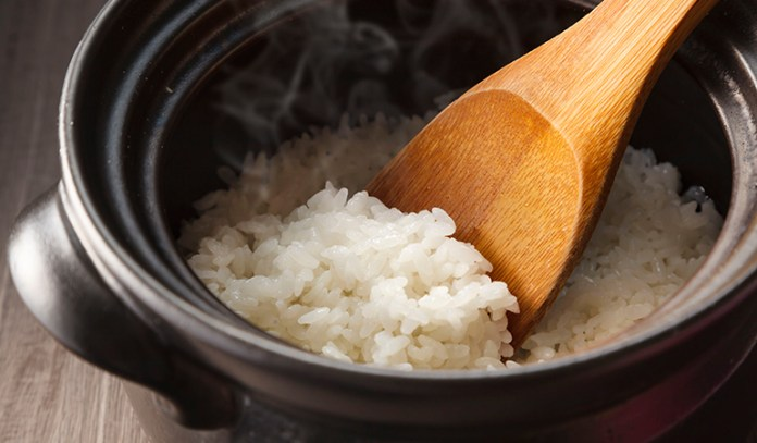Cook rice in a lot of water and drain the excess