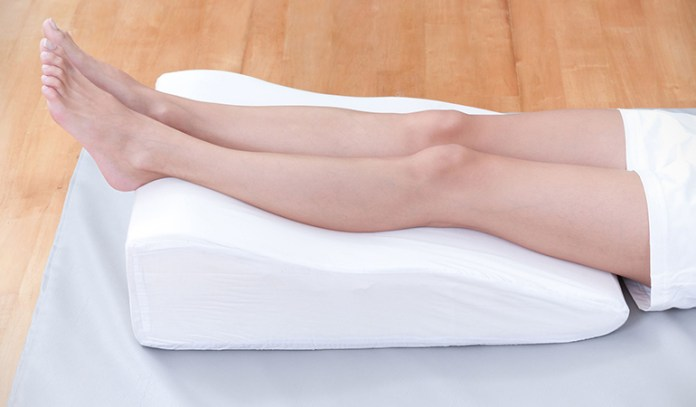 If your bottom half is swollen, placing your legs on a pillow while lying down will re-direct fluid in the other direction.
