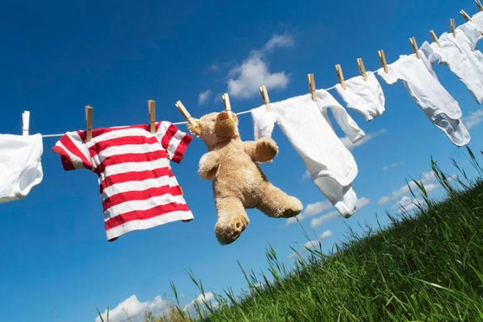 Drying clothes on a clothesline prevents the dryer from heating the house