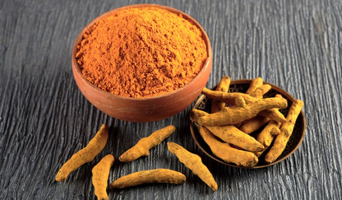 Turmeric, an alkaline root, suppresses tumor cells while offering antioxidant effects.