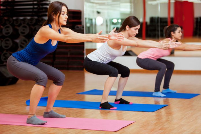 Squats target various muscle groups in the body