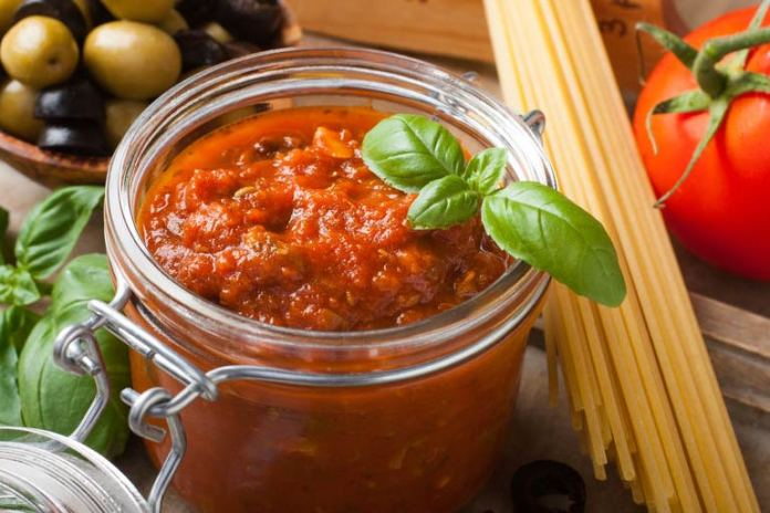 1/2 cup of canned tomato sauce contains 750 milligrams of sodium.