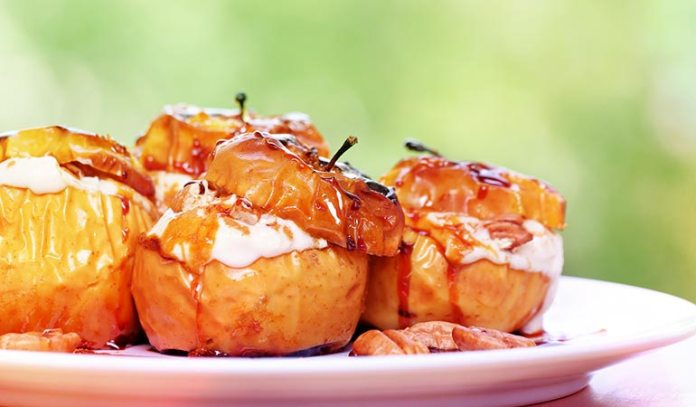 Baked apples are stuffed with ricotta cheese and honey is used
