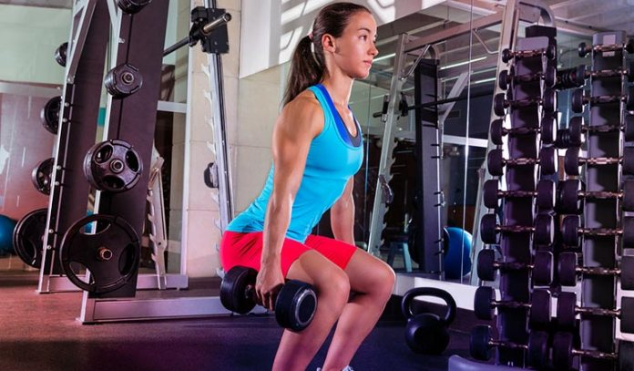 Dumbbell squats tone and strengthen your calves and the hamstrings