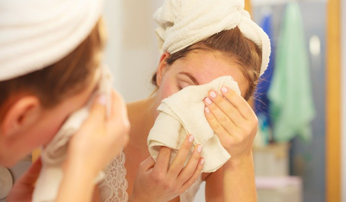 Using a soft cotton cloth dipped in warm water, apply gently around the eyelids