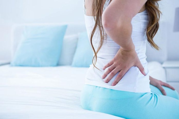 How are back pain and breast cancer related?