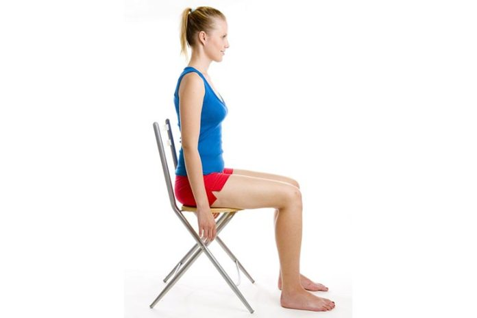 seated pillow squeeze exercise