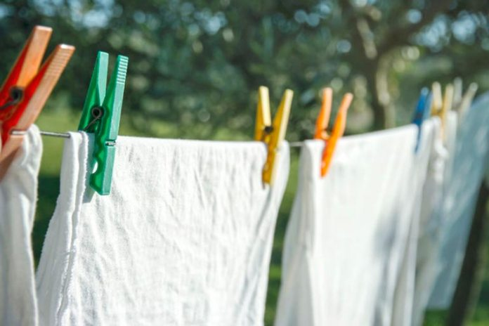 Dry the clothes outside of the house