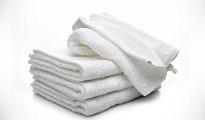 A warm towel helps loosen the mucus and bring it out of the nasal passages effectively.