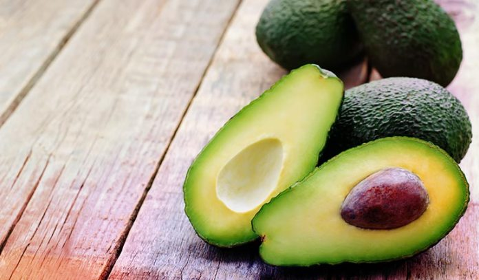 Avocados with yellow at the base of their stems are ripe