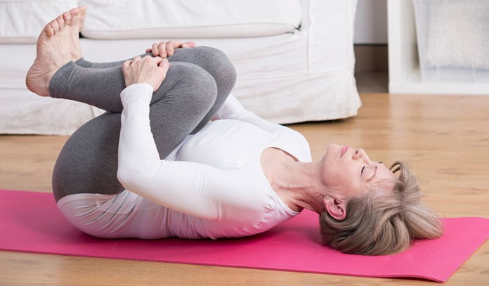 Double-knee torso rotation stretches the hips and back.