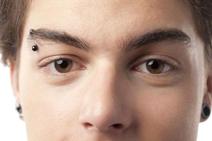 Eyebrow piercing can cause pimples on eyebrows