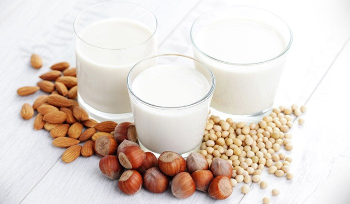 Use soy milk or almond milk to make your coffee healthy