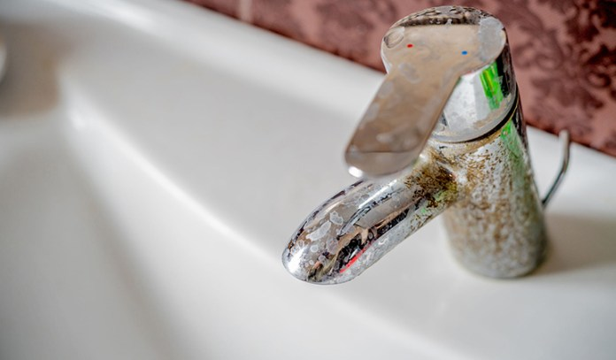 use salt to clean dirty faucets and fixtures