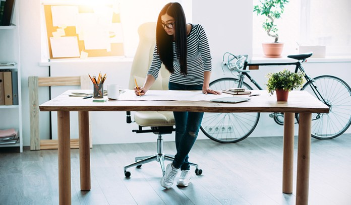 Stand at your desk to prevent back pain and lethargy