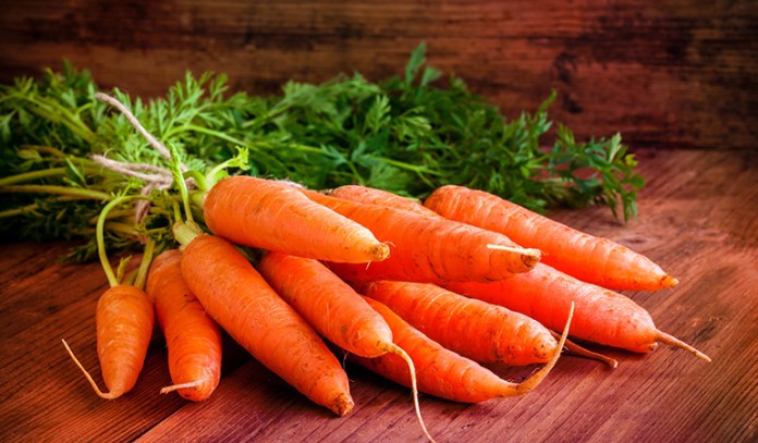 Every half-cup serving of boiled carrots cooked from raw contains 10.7 mcg of vitamin K.