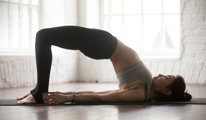 The bridge pose activates your core and strengthens your back and wrists.