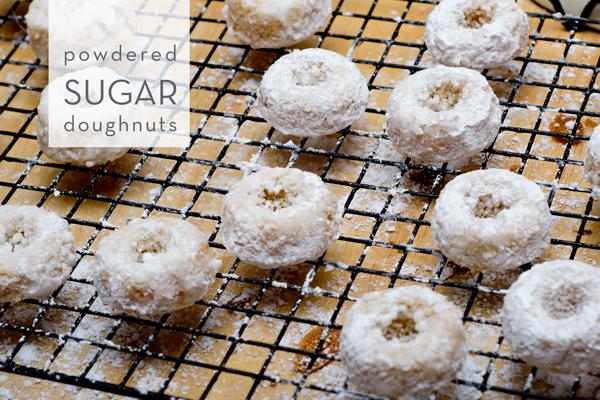 gluten free dairy free powdered sugar doughnuts on a wire rack