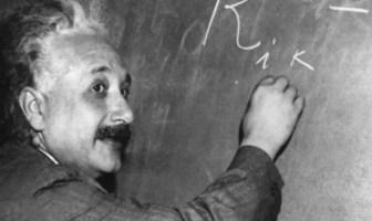 Albert Einstein (1879-1955) who developed the theory of relativity on a blackboard
