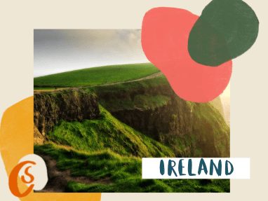 cliffs of moher with green grass at sunset