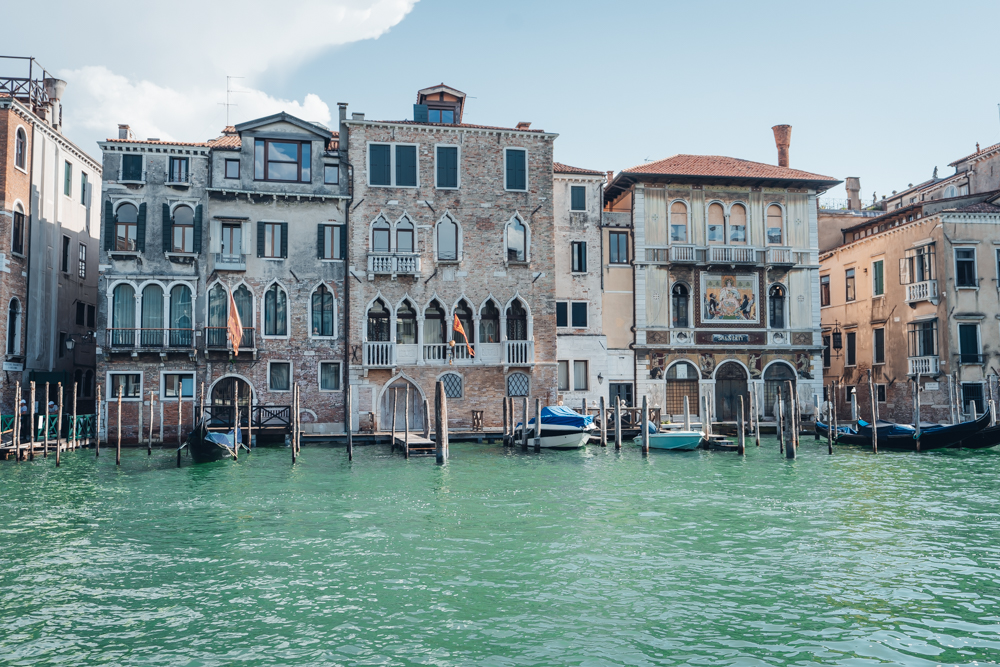 venice canal lined with historic buildings