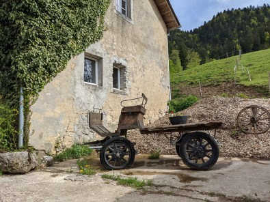 old farm tractor at le coue bio farm camping in Switzerland