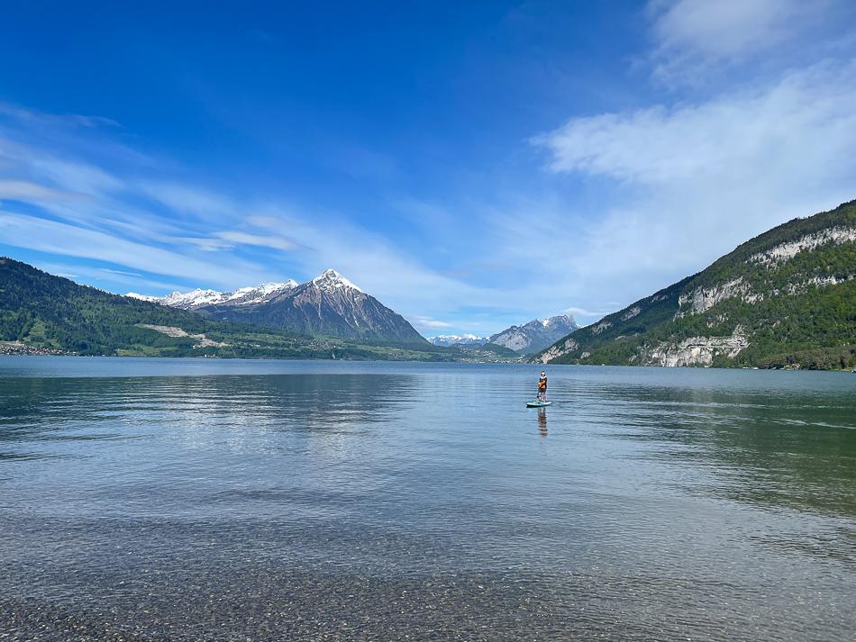 Girl paddleboarding at Thunersee Switzerland