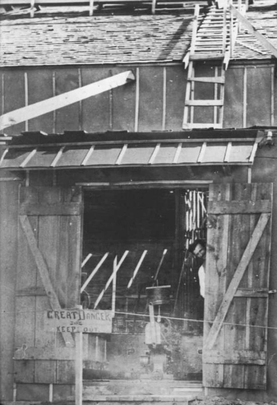 A rare photograph of Nikola Tesla standing outside of his Colorado Springs laboratory taken in 1899.