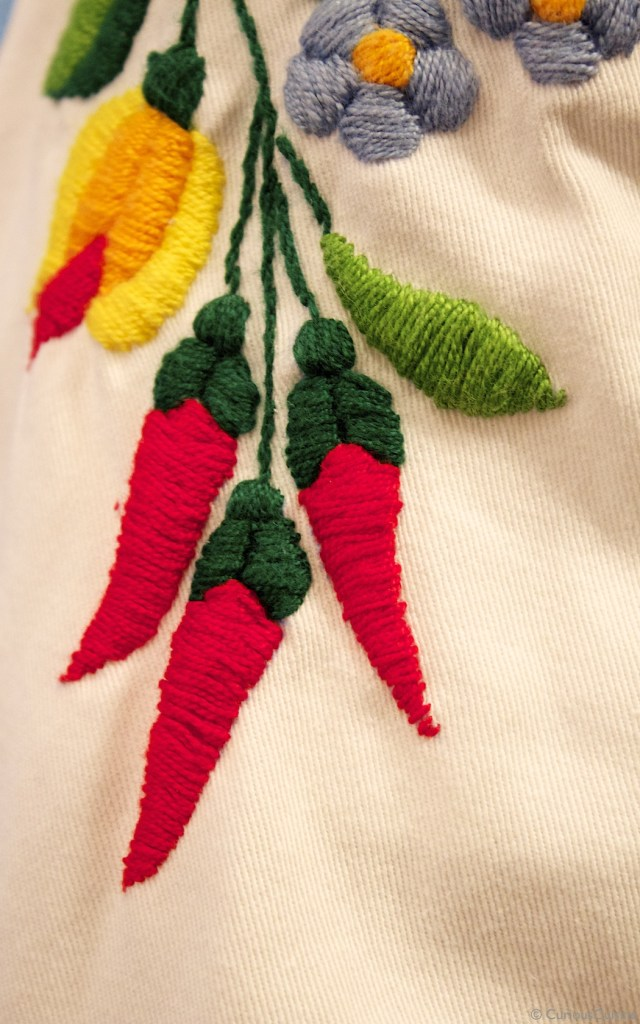 Paprika embroidered into Embassy of Hungary Chef Szabo Balazs' coat; one colourful part of a lively traditional pattern.