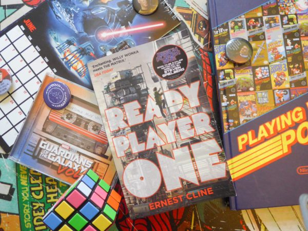 Ready Player One by Ernest Cline surrounded by retro 1980s items
