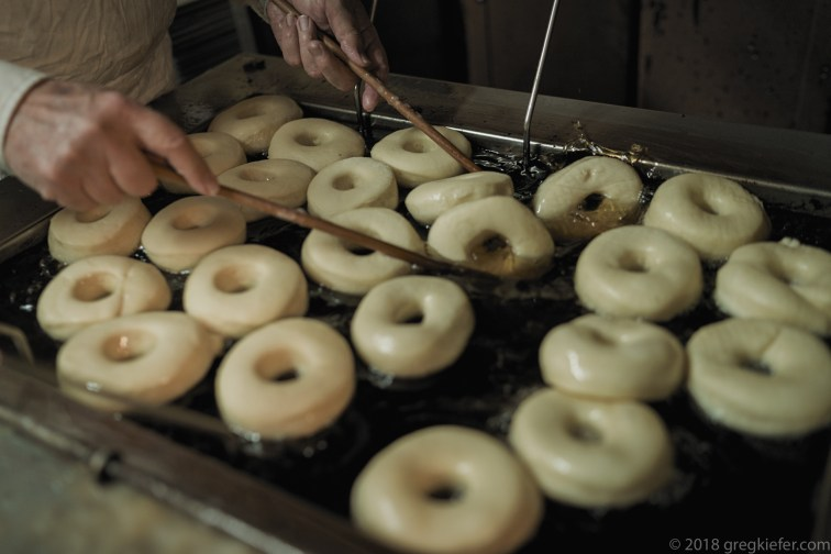 Frying fresh donuts - Lehi Bakery