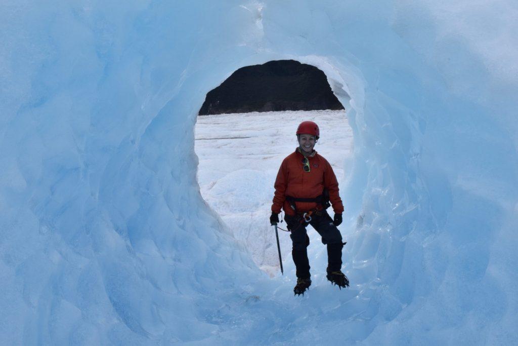 Image of Erin trekking on a glacier in Juneau, Alaska