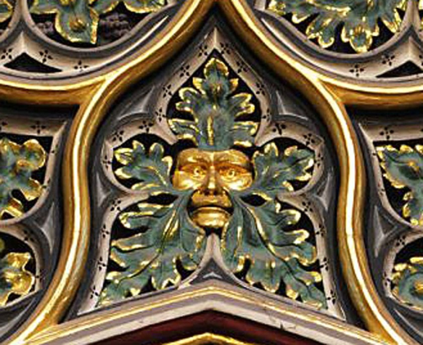 Westminster Abbey green man with gold face sprouting green leaves.