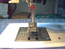 decided to thread then knot my two threads before installing for some twin needle work - did nicely!